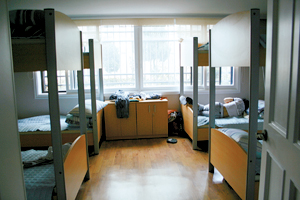 A player naps during break time. Rooms with bunk beds are for second-tier players.
